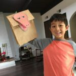 Theo is proudly showing his creation, the Tyrannosaur Rex, an idea that we got from using Renzulli Learning.